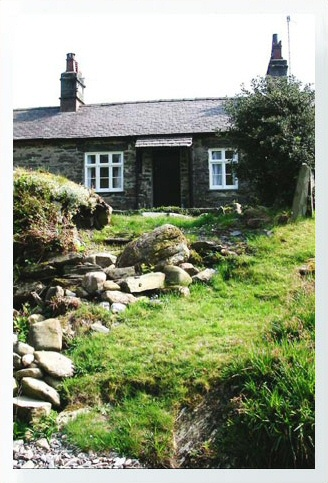 Riverbank Cottage, Self Catering Holiday Cottage, Capel Curig, Snowdonia National Park, North Wales, UK, TheCanoeMan. A delightful 2 bedroom cottage located in the centre of the Snowdonia National Park.Riverbank Cottage is one of a row of traditional longhouse cottages situated on the edge of the small village of Capel Curig in a quiet, secluded spot. It has an open plan kitchen / lounge / diner with a modern fitted kitchen and a multifuel stove in an inglenook fireplace. There is a modern shower room with double shower cubicle, and a four poster bed in the master bedroom, which has delightful views of the river Llugwy running along the bottom of the garden.