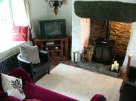 Main living area, including television and stove - Riverbank Cottage, Self Catering Holiday Cottage, Capel Curig, Snowdonia National Park, North Wales, UK, TheCanoeMan